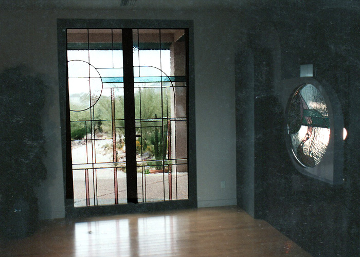 Aluminium doors, clear glass and some color, bevels, with similar window in foyer